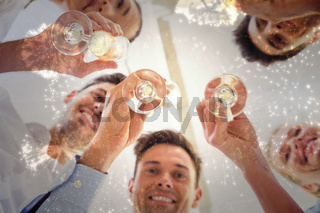 Composite image of casual business team toasting with champagne