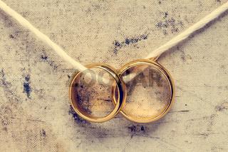 Wedding rings hanging on rope