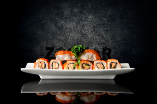 Sushi and rolls in plate