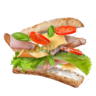 Sandwich with falling ingredients in the air