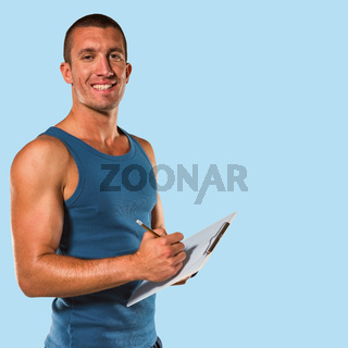 Composite image of portrait of confident sports coach writing on clipboard