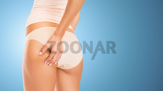 close up of woman in underwear touching buttock