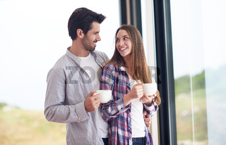 relaxet young couple drink first morning coffee