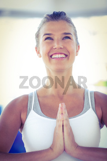 Happy woman with hands joined