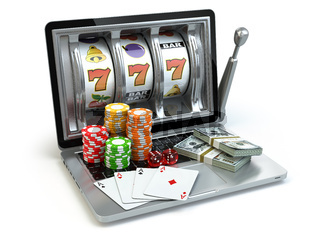 Casino online concept, gambling. Laptop slot machine with dice, cards and packs of dollar.
