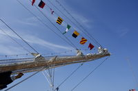 Bow of a tall ship, blue sky background