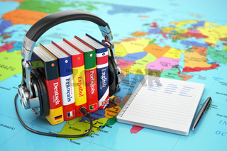 Learning languages online. Audiobooks concept. Books and headphones on the map world.