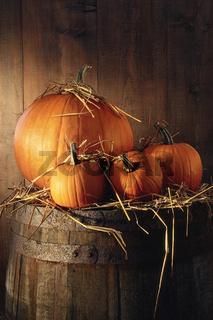 Pumpkins on old barrel