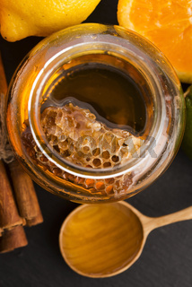 honey with citrus fruit and cinnamon
