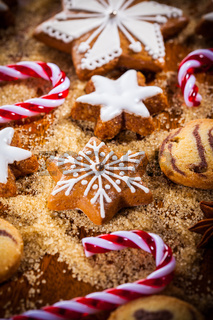 Homemade gingerbread and cookies for Christmas on wooden plate