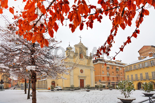 City square under snow. Alba, Italy.