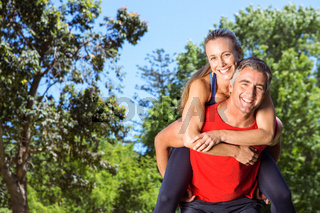 Fit couple having fun in the park