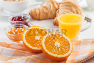 Breakfast with fresh orange juice and delicious French croissants