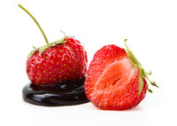 Strawberries and chocolate on a white background