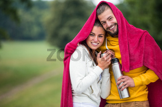 Happy couple under a blanket
