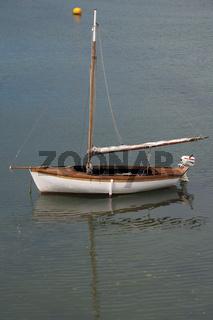 A small sailboat.