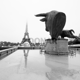 Sculptures on Trocadero and Eiffel Tower in Paris.