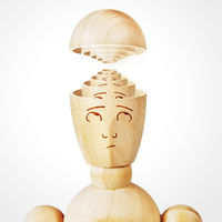 Many human heads are inserted one into the other. Concept of complexity of the mind. Abstract image with a wooden puppet