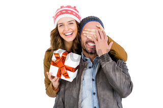 Woman giving a surprise gift to her man