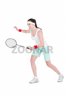 Female athlete playing badminton