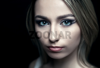 face of a beautiful girl  on a black background