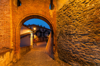 Old brick arch in town of Barolo.