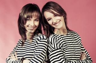 Two young fashion girls in a striped shirts