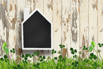 House shaped chalkboard on wooden background