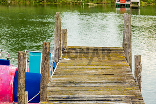pier and moored pedal boat