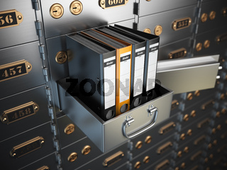 Ring binders on a safe deposit box. Confidential information concept.