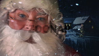 Closeup of Santa Claus with night scene in background
