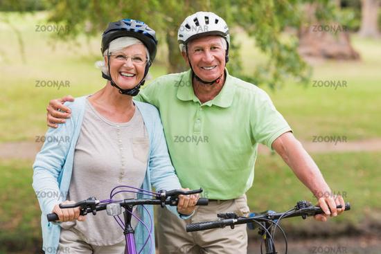 Happy senior couple on their bike