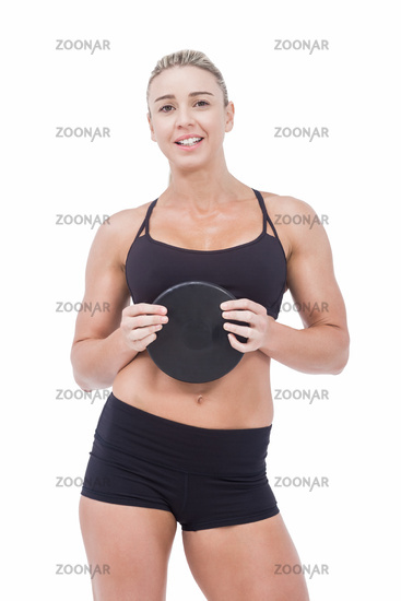 Female athlete holding discus