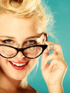Retro pin up woman wearing eyeglasses.