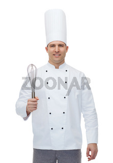 happy male chef cook with whisk