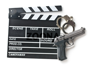 movie clapper and gun with handcuffs