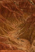 Dry valley red orange sand stone rock formation in hot desert of Tatacoa, Huila