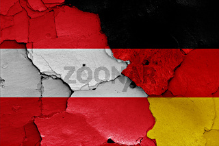 flags of Austria and Germany painted on cracked wall