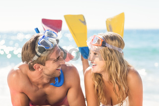 Happy couple with snorkel and flippers