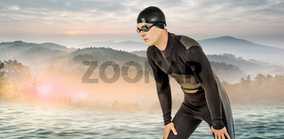 Composite image of swimmer in wetsuit and swimming goggles