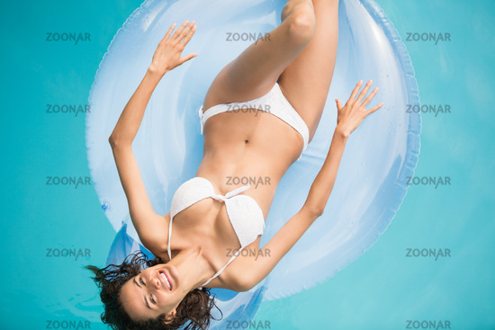 Beautiful woman relaxing on inflatable ring