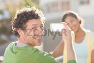 couple taking photos of themselves