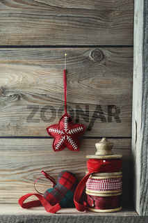 Ribbons and Christmas ornaments on wood shelf