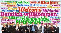 Business Team sagt Willkommen in vielen Sprachen