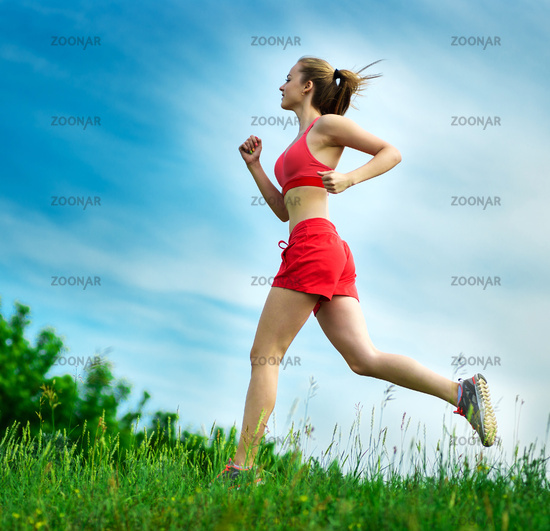 Young woman running summer park rural road. Outdoor exercises. J