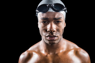 Portrait of swimmer in swimming goggles and swimming cap