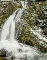 by rocks falling water in Lierbachtal Black Forest in winter