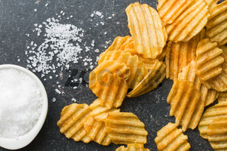 Crinkle cut potato chips with salt.