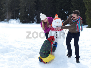happy family making snowman