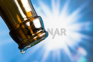 Last drop of an empty beer bottle